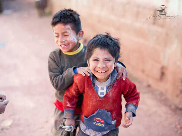 two children laughing in a village